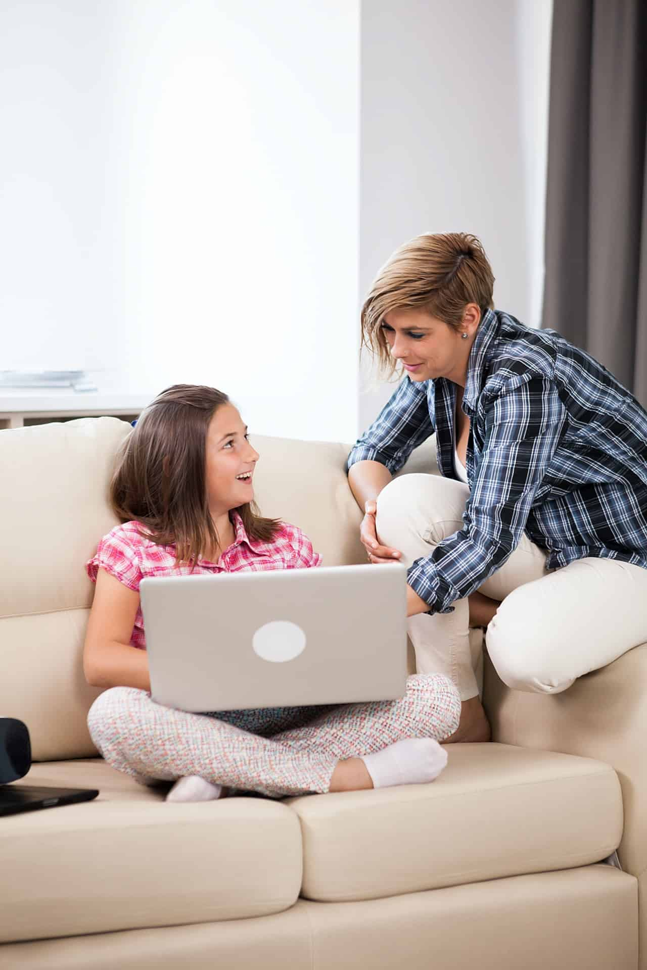 cute girl with a laptop in hands and her mother PY9XFJN - The Appel Orthodontics Blog